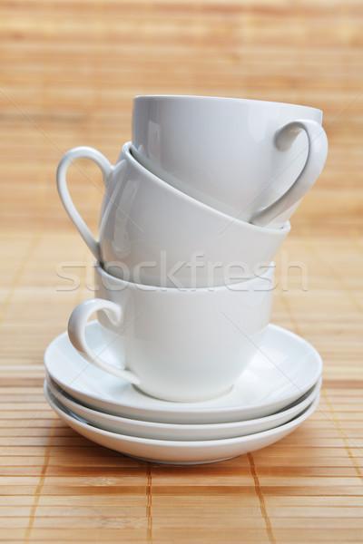 Kávéscsészék három fehér fából készült tea reggeli Stock fotó © taden