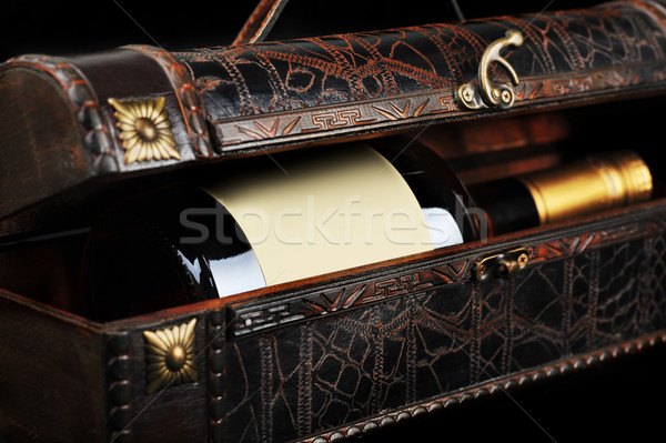 Cognac bouteille bois cas verre noir Photo stock © taden