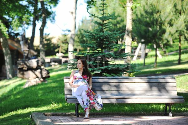 Bella donna seduta panchina felice Foto d'archivio © taden