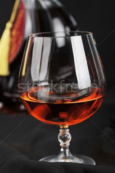 Verre cognac simple bouteille noir eau Photo stock © taden