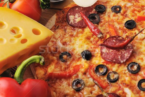 Saboroso pizza tomates queijo azeitonas pretas Foto stock © taden