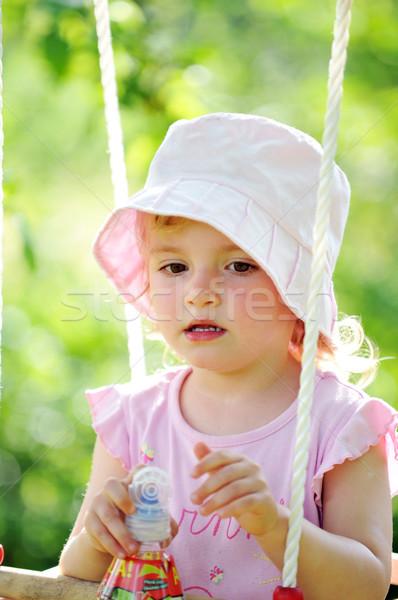 ストックフォト: 女の子 · 公園 · 春 · 赤ちゃん · 顔 · 草