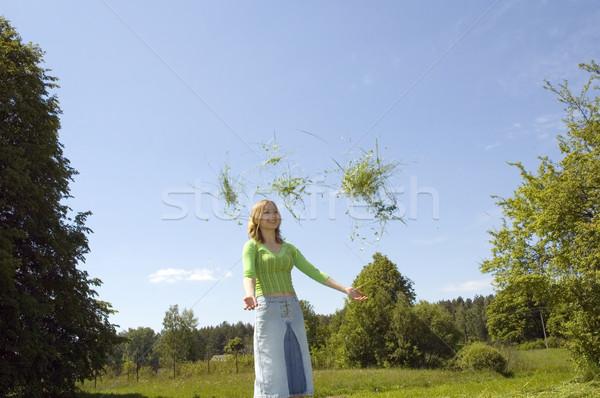 girl throwing grass Stock photo © taden