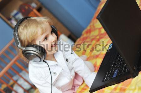 girl  in ear-phones Stock photo © taden