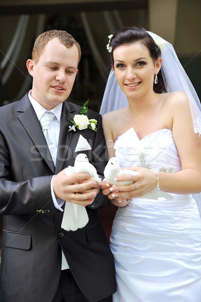 newlyweds with  doves Stock photo © taden