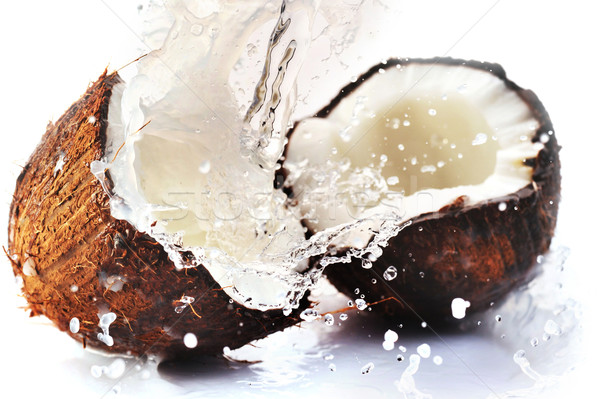 cracked coconut with splash Stock photo © taden
