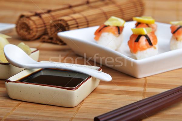 Sushi somon plaka bambu peçete balık Stok fotoğraf © taden