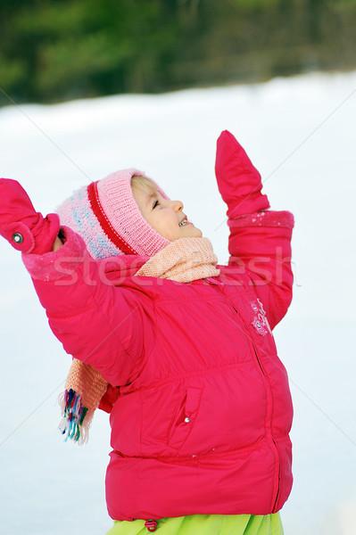 girl costs on snow Stock photo © taden