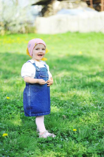 Lány kék ruha kislány virág gyerekek Stock fotó © taden