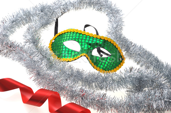 mask and silvery garland  Stock photo © taden