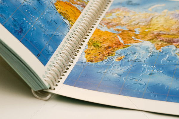 Opened book with map on it Stock photo © taden