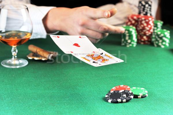 Kart oynamak adam oturma tablo iskambil kartları Stok fotoğraf © taden
