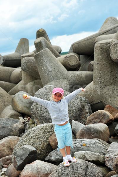 Stock photo: girl  on stones