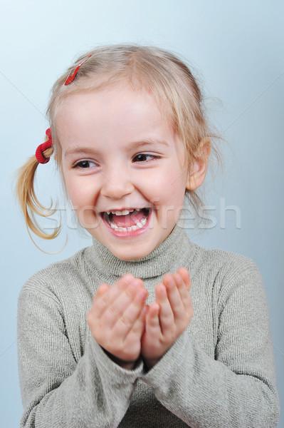 Petite fille portrait blond mains visage filles Photo stock © taden