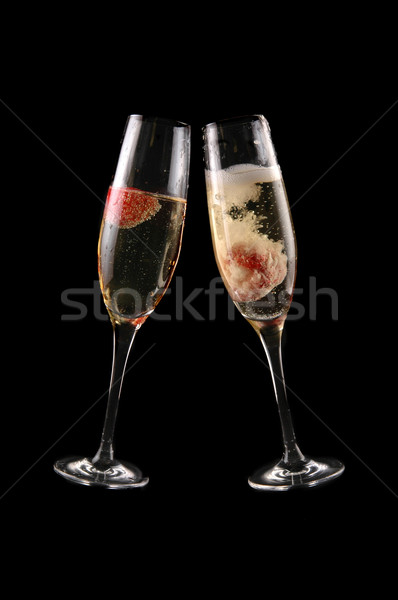 glass of champagne with strawberry Stock photo © taden