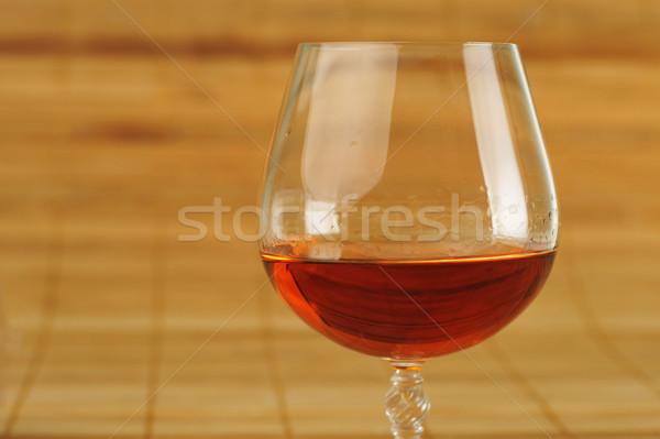 Verre cognac élégante bambou serviette vin Photo stock © taden
