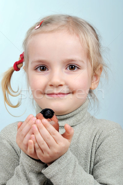 little girl and bullfinch Stock photo © taden