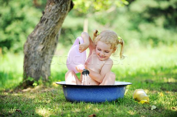 Petite fille eau chaud été jour main Photo stock © taden