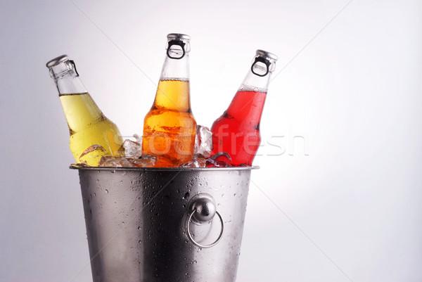 Bière bouteilles trois différent seau glace Photo stock © taden