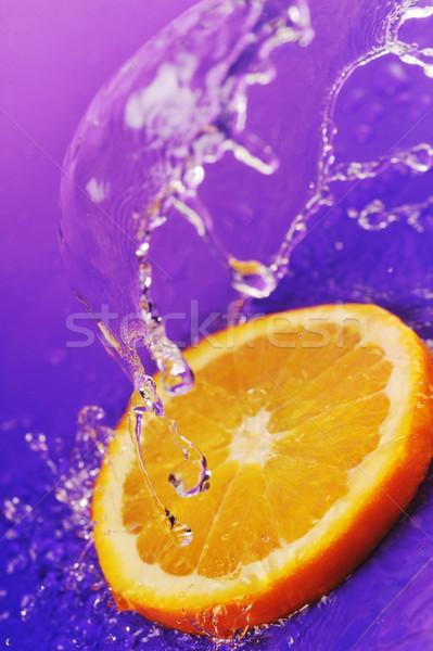 Stok fotoğraf: Sulu · turuncu · sıçraması · parlak · mor · gıda