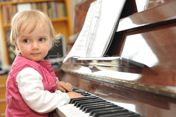 girl plays  piano Stock photo © taden