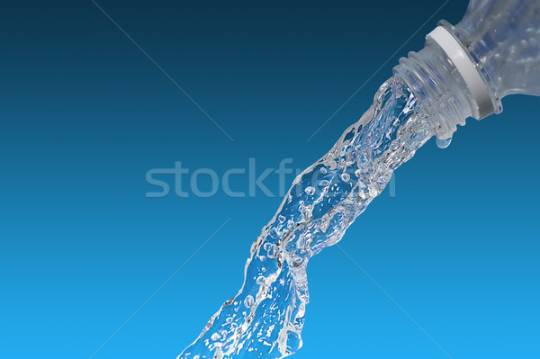 Water flows from  bottle Stock photo © taden