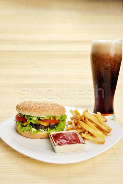 Gyorsételek ízletes hamburger sültkrumpli kóla étel Stock fotó © taden