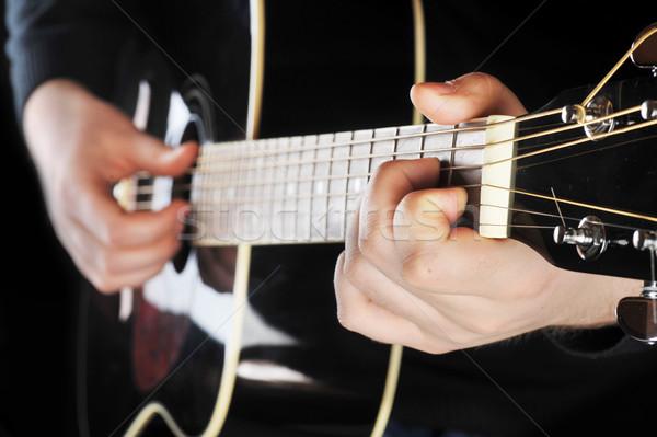 Siyah gitar eller müzisyen oynama Stok fotoğraf © taden