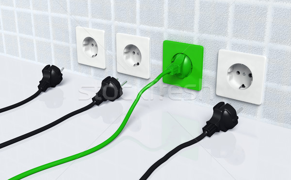 Ecological green plug into a green socket Stock photo © TaiChesco