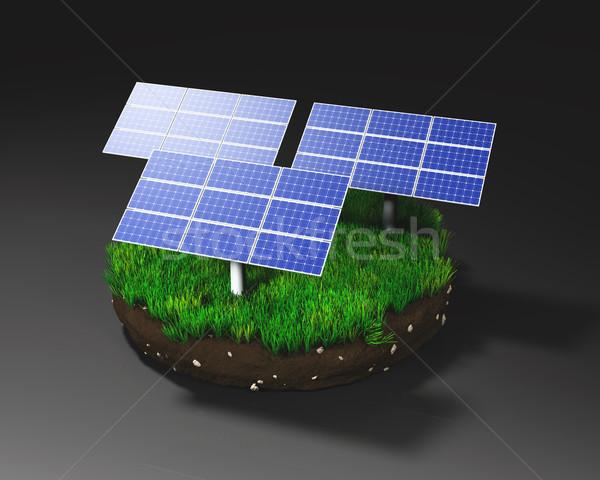 Solar panels on clod of earth Stock photo © TaiChesco