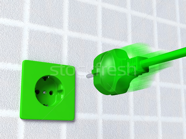Green plug goes into a socket Stock photo © TaiChesco