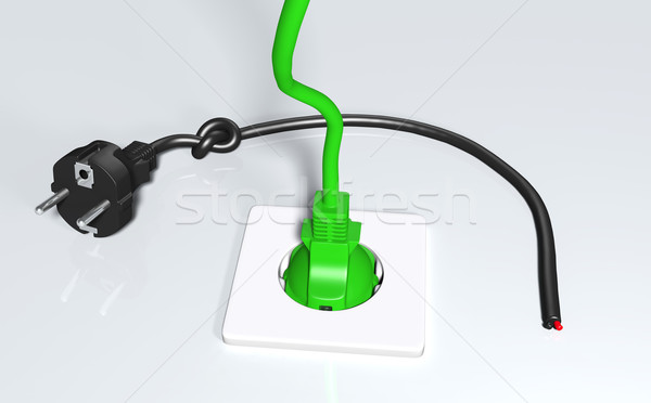 Stock photo: Ecological green plug connected