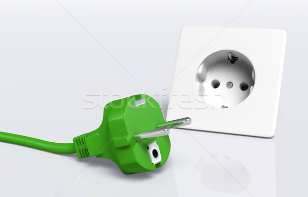Green plug and socket Stock photo © TaiChesco