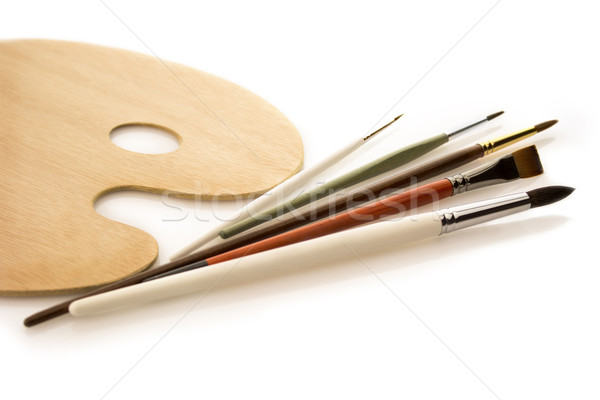 Brushes with wooden palette on white Stock photo © Taiga