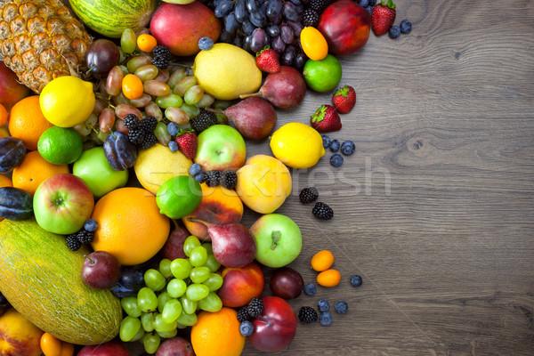 Mix of Fresh Fruits  on dark wooden table  Stock photo © Taiga