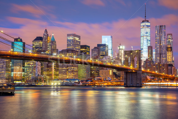 Manhattan skyscrapers and Brooklyn Bridge, New York, USA Stock photo © Taiga