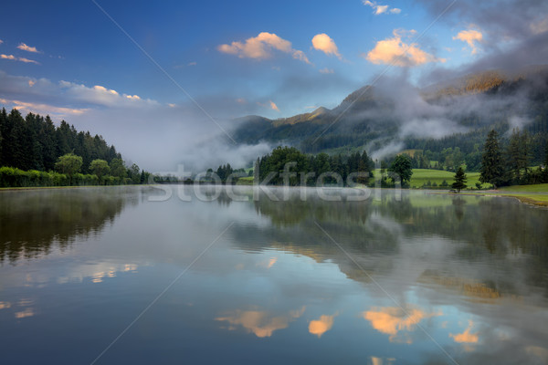Foggy Morning on lake landscape, with beautiful clouds and refle Stock photo © Taiga