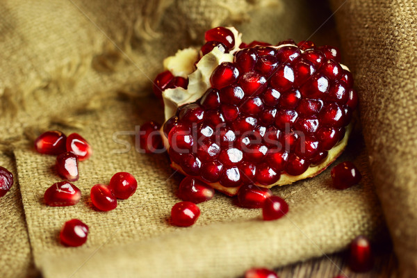 Raw pomegranate with seeds on sacking Stock photo © Taiga