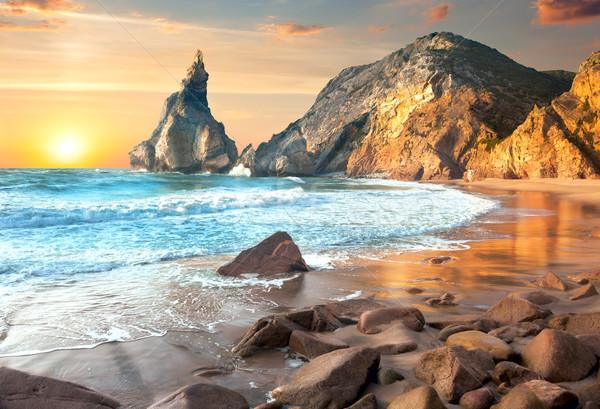 Sea Landscape at Sundown time, beautiful rocks and stones beach Stock photo © Taiga