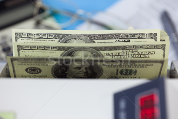 Dollars  banknots in the counting machine  Stock photo © Taiga