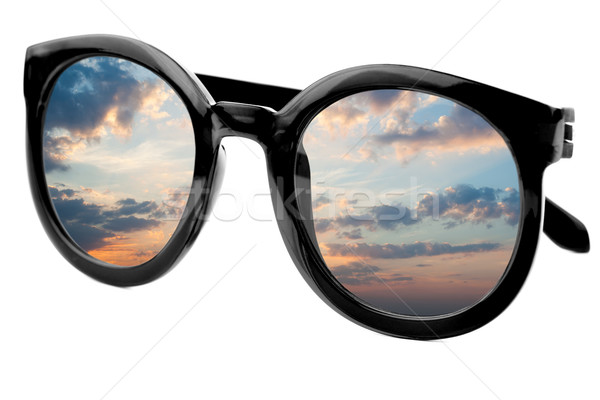 Sunglasses have a sunrise sky reflecting on  isolated  backgroun Stock photo © Taiga