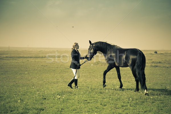 horsewoman trains the horse / split vintage toned Stock photo © Taiga