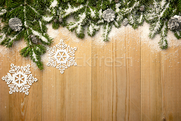 Christmas background with firtree, decorative snowlakes and cone Stock photo © Taiga