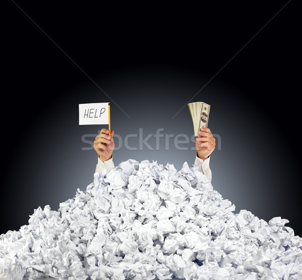 Help me! Person under crumpled pile of papers with a help sign a Stock photo © Taiga