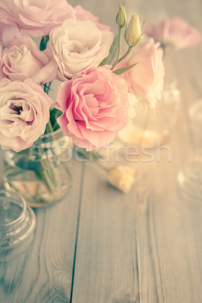 Bouquet of beautiful pink flowers on old wooden texture Stock photo © Taiga