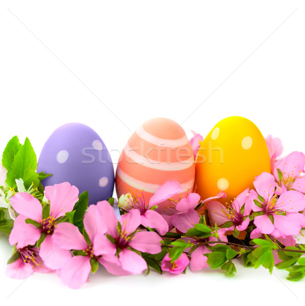 Handmade Easter Eggs frame with spring flowers, isolated  Stock photo © Taiga