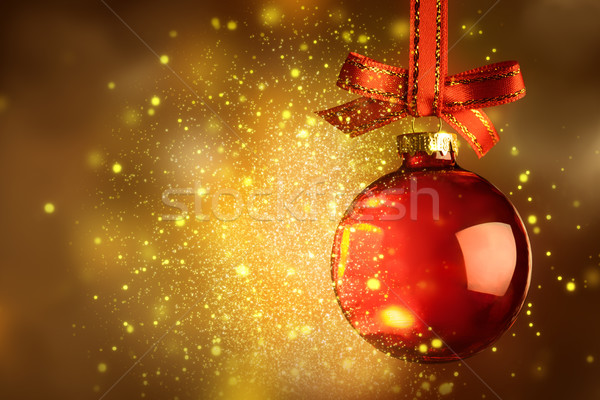 Christmas red bauble with sparkle over magic glitter shiny backg Stock photo © Taiga