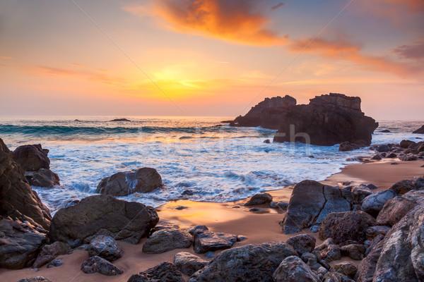 Tengeri kilátás naplemente idő óceán part Portugália Stock fotó © Taiga