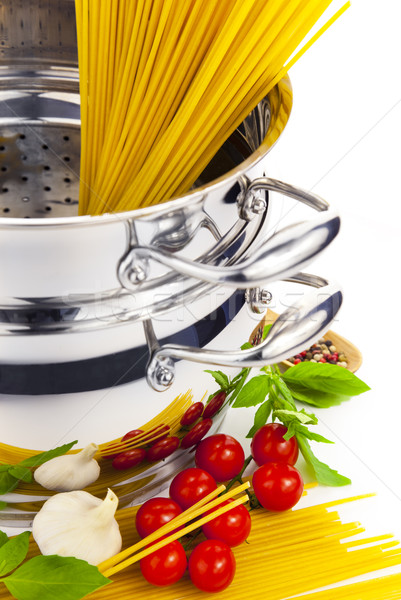 Italian cooking / pasta, tomatoes, basil, garlic and saucepan Stock photo © Taiga