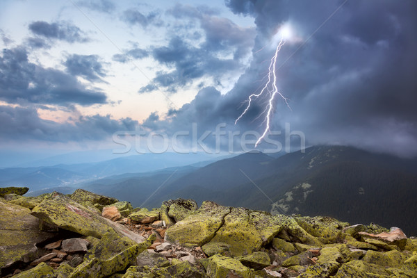 thunderstorm with lightening and dramatic clouds in mountains Stock photo © Taiga